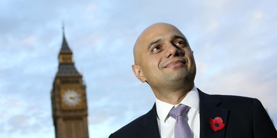 Sajid Javid, financial secretary to the U.K. treasury, poses for a photograph near the Houses of Parliament following an interview in London, U.K., on Tuesday, Nov. 5, 2013. U.K. industrial production rose more than economists forecast in September, helped by a rebound in manufacturing after a slump the previous month. Photographer: Chris Ratcliffe/Bloomberg via Getty Images